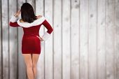 Rear view of sexy santa girl against blurred wooden planks
