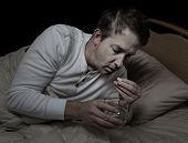 Sick Man Taking Medicine With Water