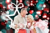 Couple with shopping bags against blurred christmas background