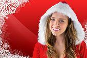 Sexy santa girl smiling at camera against christmas themed snow flake frame