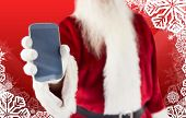 Santa claus showing smartphone against christmas themed snow flake frame