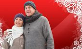 Mature winter couple against christmas themed snow flake frame