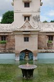 fountain on the ancient pool at taman sari water castle - the royal garden of sultanate of jogjakart