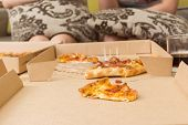 Friends' party, focus on the piece of pizza.