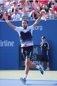 Professional tennis player Marin Cilic celebrates victory after US Open 2014 quarterfinal match