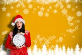 Woman shocked at the time against blurred fir tree background