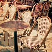 old-fashioned coffee terrace with tables and chairs,paris France