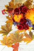 Beautiful autumn composition in pumpkin on color wooden background