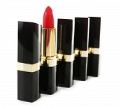 Individuality concept. Beautiful lipsticks isolated on white