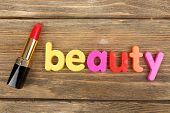 Beauty word formed with colorful letters on wooden background