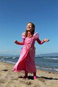 Happy princess on a beach