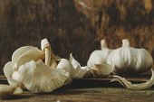 White garlic on a wooden table