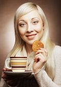 young blond woman with coffee and cookies