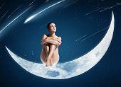 Healthy Woman Sitting On Shiny Moon