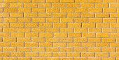 The Yellow Brick Wall Use As Background With Black Vignette.