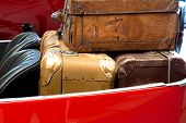 Old Leather Suitcases In  Car Trunk