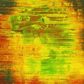 Dirty and weathered old textured background. With yellow, brown, orange, green patterns