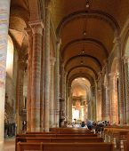 POITIERS, FRANCE - JUNE 26, 2013: People in the church Notre-Dame la Grande. Built in XI century, the church is most known for the West front adorned with statuary