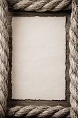 ropes and old vintage ancient paper at wooden background