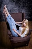 Young blonde girl on chair