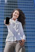 White Shirt Businesswoman Showing Mobile Screen