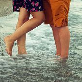 Young Couple In Love Hugging And Kissing On The Beach.