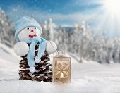Winter holiday happy snow man with blur landscape on background