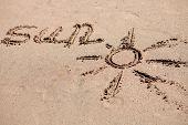Written on the sand of the beach: Sun