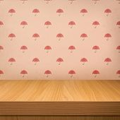 Empty Wooden Table Over Vintage Wallpaper With A Pattern Of Red Umbrellas