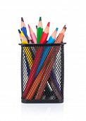 Colorful pencils in holder. Isolated on white background