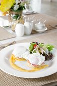 Eggs Benedict- toasted English muffins, ham, poached eggs, and delicious buttery hollandaise sauce for breakfast
