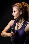 Close-up Portrait Young Girl With Dreadlocks Training With Dumbbells