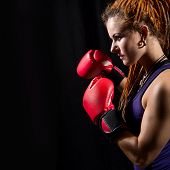 Beautiful Girl With Red Boxing Gloves, Dreadlocks On A Black Background