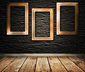 Three Wooden Frames On A Wall.