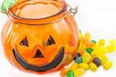 Halloween Pumpkin Glass With Jelly Beans Isolated