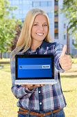 Beautiful Woman Holding Laptop With Search Bar On Screen And Thumbs Up In Park
