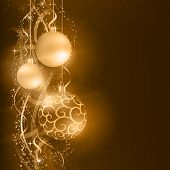 Border with golden, desaturated Christmas balls hanging over a golden wavy pattern with stars and snow flakes on a dark brown background. Vivid and festive for the Christmas season to come.