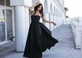 Beautiful Woman With Dark Hair In Elegant Black Dress