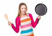 Housewife hold with wooden spatula and pan