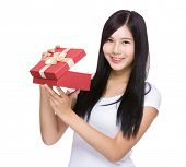 Woman open with red gift box