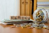 Money Saving Word With Coins And Banknotes