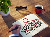 Businessman Drawing Togetherness Concept on a Note Pad