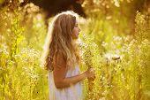 Cute Little Girl Among White Wildflowers