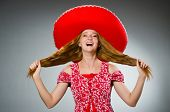 Mexican woman wearing red sombrero