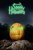 Spooky Halloween Neon Pumpkin In On A Rock In The Darkness