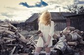 picture of cunning  - The girl with the axe on the wood background - JPG