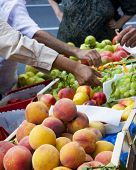 pic of bartering  - Fresh produce market with people purchasing items - JPG
