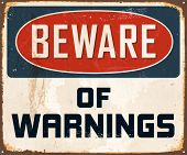 Vintage Metal Sign - Beware of Warnings - Vector EPS10. Grunge effects can be easily removed for a brand new, clean design.