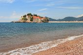 The Beach Of The Adriatic Sea And The Island Of Sveti Stefan.