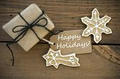 White Happy Holidays On A Banner With Christmas Decoration